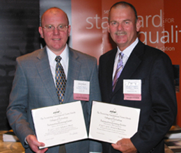 "Steve Hiscox, President and CEO of ATC and Don VanDemark, Vice President and COO of ATC receiving ""School of Merit"" and ""School of Distinction"" awards at the 2008 ACCSC Professional Development Conference Awards Ceremony."